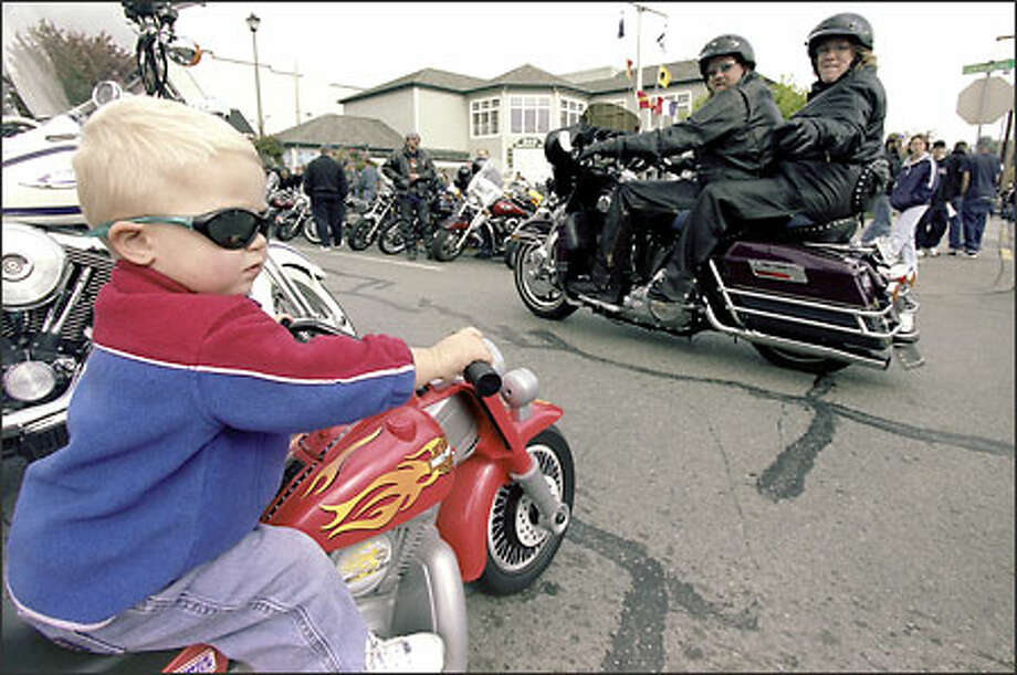 Two-year-old Anacortes resident Brandon Broome has the right style -- and vehicle -- yesterday for the annual Oyster Run, the largest motorcycle rally in the Pacific Northwest. Photo: Loren Callahan/Seattle Post-Intelligencer