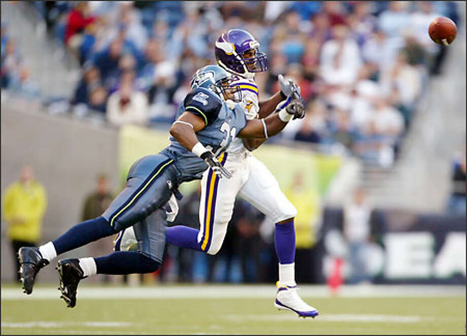 Seahawks free safety Marcus Robertson knocks away a pass intended for Randy Moss. A strong, consistent effort by the Seattle secondary held the Vikings' mercurial wide receiver to six catches for just 50 yards and no touchdowns. Photo: / Associated Press