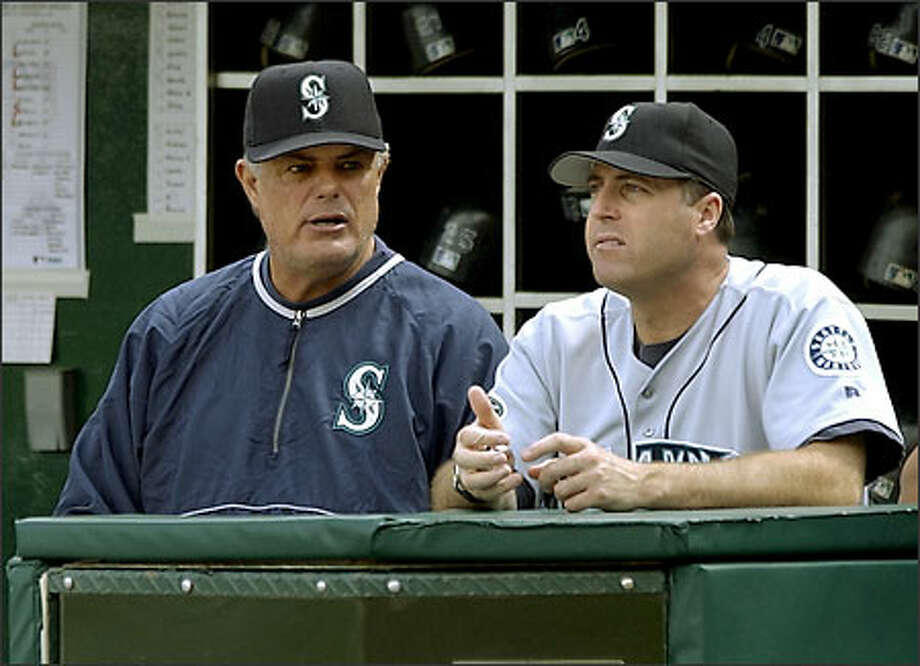 Manager Lou Piniella talks with pitching coach Bryan Price after Ismael Valdes gave up a grand slam to Anaheim's Troy Glaus in the season finale. Photo: / Associated Press