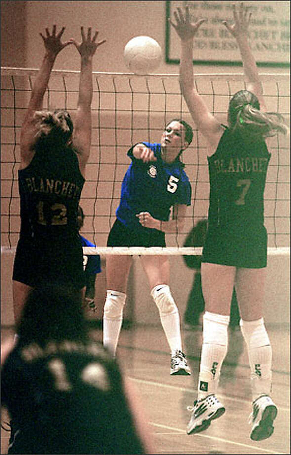 Laura Nuyen of Seattle Prep drives the ball against Blanchet defenders Shirley Bocian (12) and Tori Ross. Photo: Loren Callahan/Seattle Post-Intelligencer