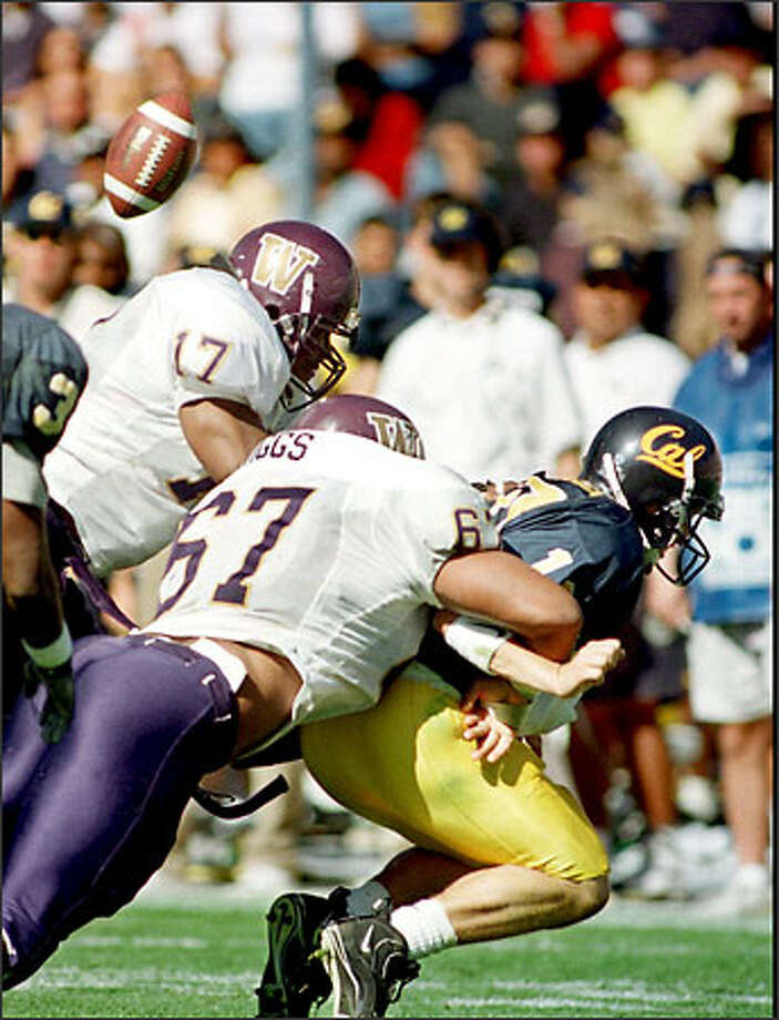 Cal's Justin Vedder fumbles as he is sacked by Lester Towns (17) and Sekou Wiggs in '97. The UW won 30-3. Photo: / Associated Press