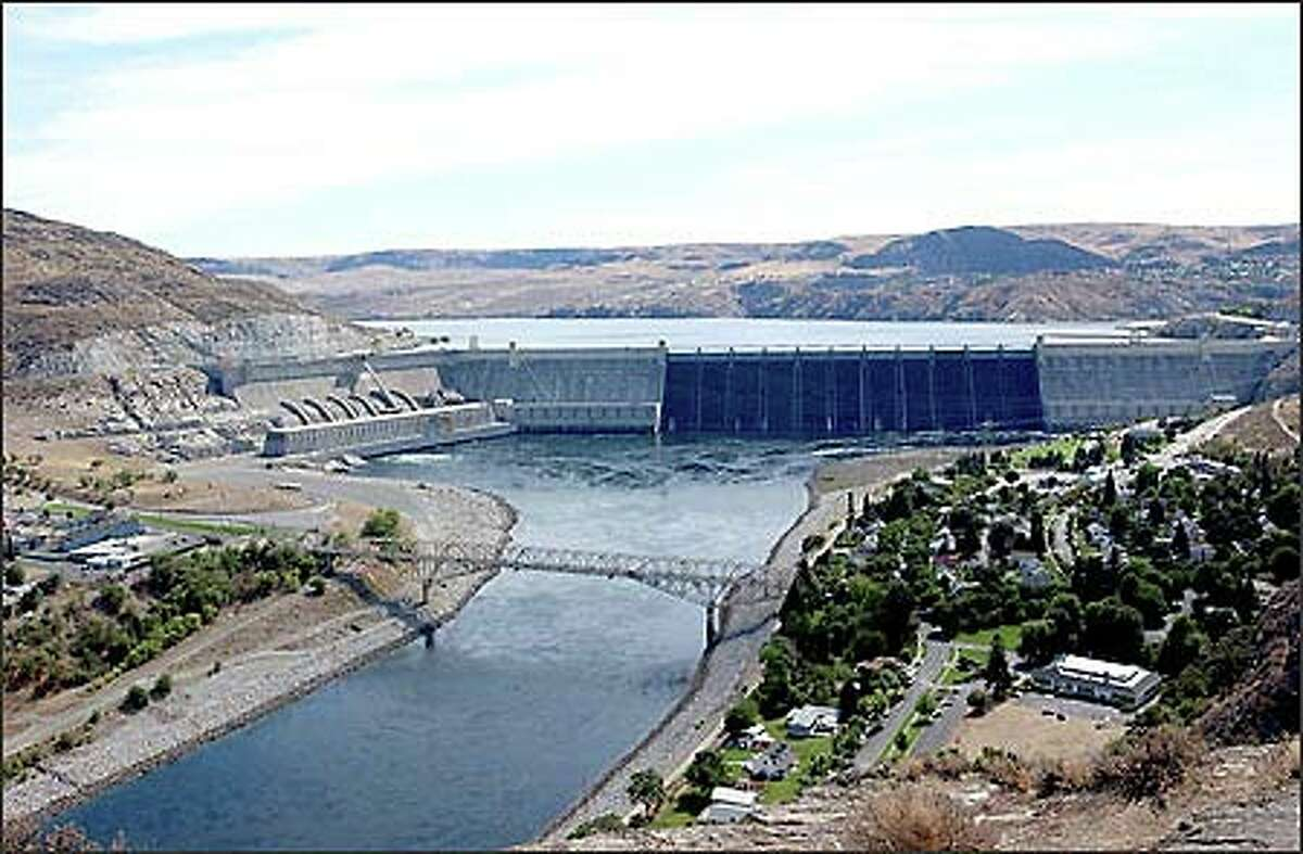 Rufus Woods, Wenatchee World publisher from 1905 to 1950, championed construction of Grand Coulee Dam. The dam and a bridge over the Columbia River as seen from Crown Point.