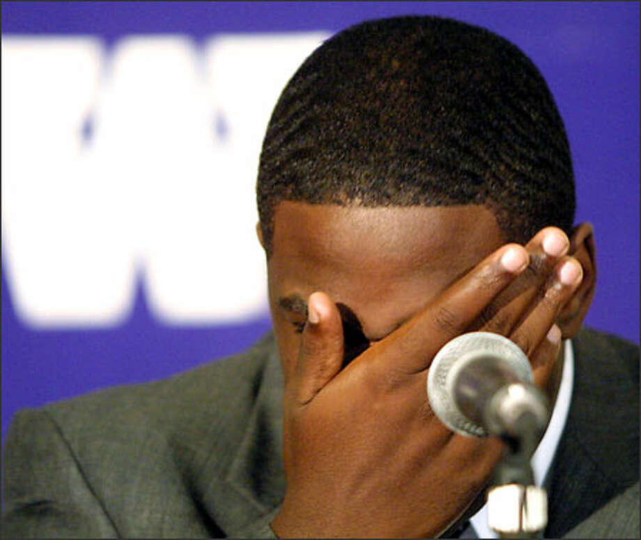 University of Washington men's assistant basketball coach Cameron Dollar reacts during a news conference in Seattle Wednesday, Oct. 2, 2002. A UW internal investigation revealed Dollar, who works under head coach Lorenzo Romar, violated several recruiting rules. Photo: / Associated Press