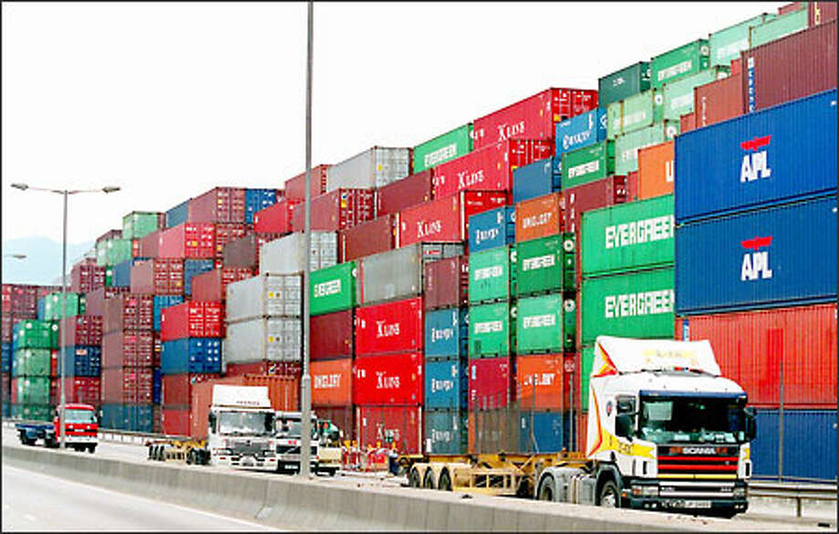 Shipping containers are stacked seven layers high at Hong Kong's port yesterday. Asian ships have been stranded by the closure of ports on the West Coast of the United States. Photo: / Associated Press
