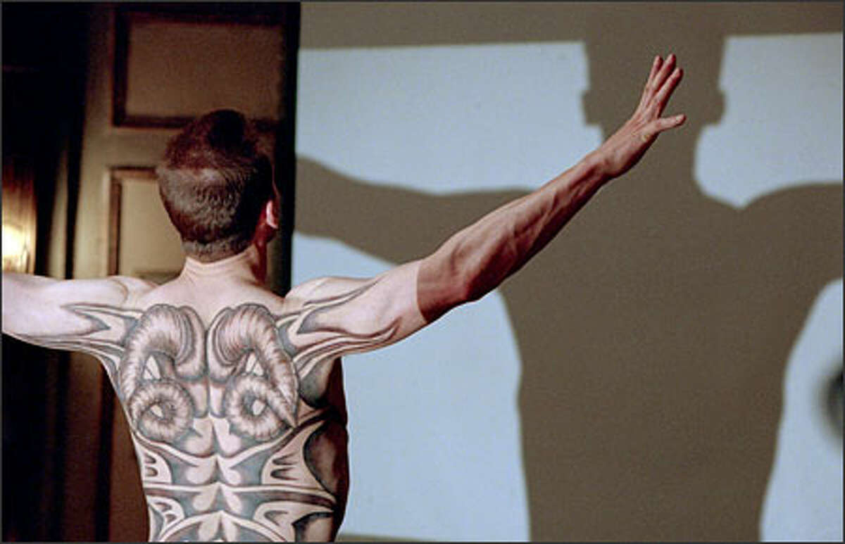 Francis Dolarhyde, played by Ralph Fiennes, believes he is becoming the Red Dragon.