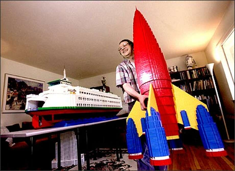 Seattle Lego enthusiast Wayne Hussey hauls out a 6-foot rocket he built with approximately 8,500 Lego pieces. Hussey's model of a Washington State Ferry has been in the works for 25 years. Photo: Scott Eklund/Seattle Post-Intelligencer