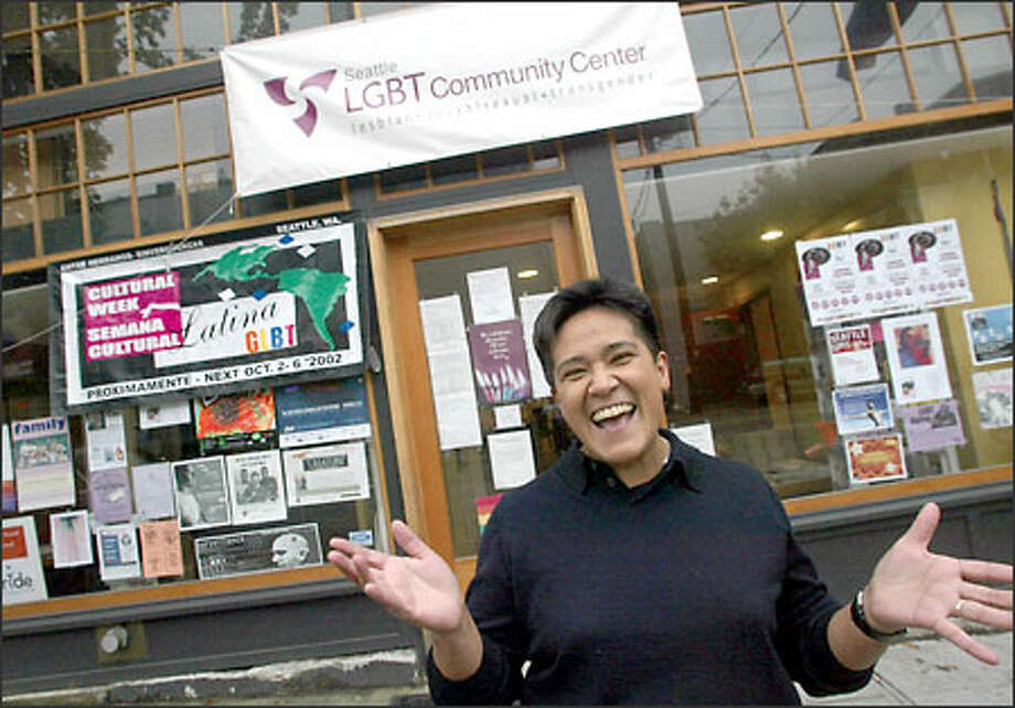 Emma Moreno jokes about how Latinos talk with their hands. She is an organizer of the gay-lesbian Latino week at the LGBT Community Center. Photo: Renee C. Byer/Seattle Post-Intelligencer