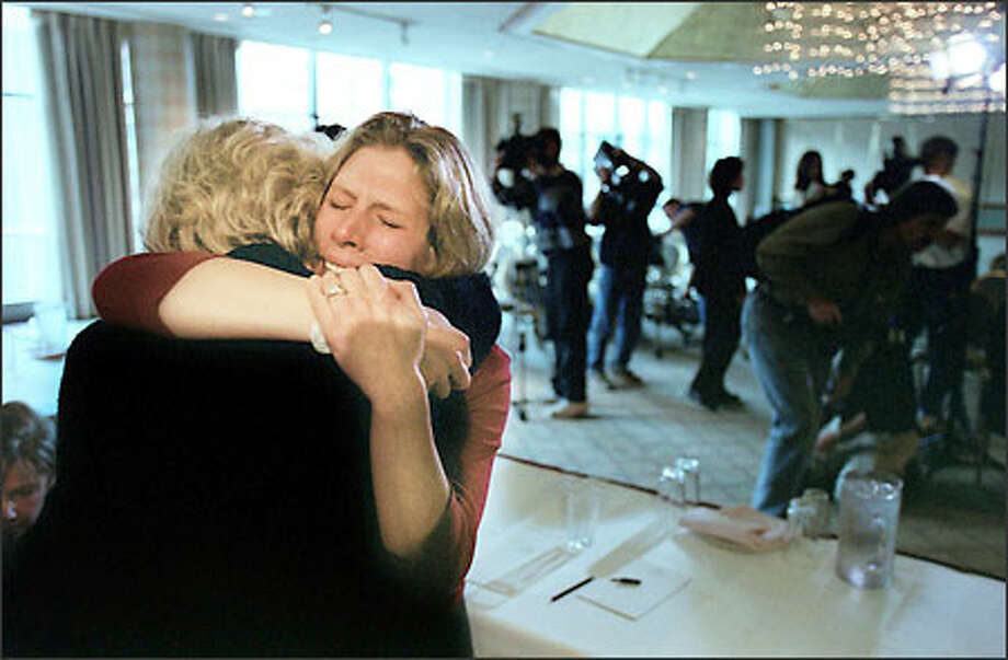 Julie Dubravetz, arrested after witnesses said she dragged her foster child from a car, gets a hug from her mother after a news conference at the Westin Hotel Friday. Photo: Paul Joseph Brown/Seattle Post-Intelligencer