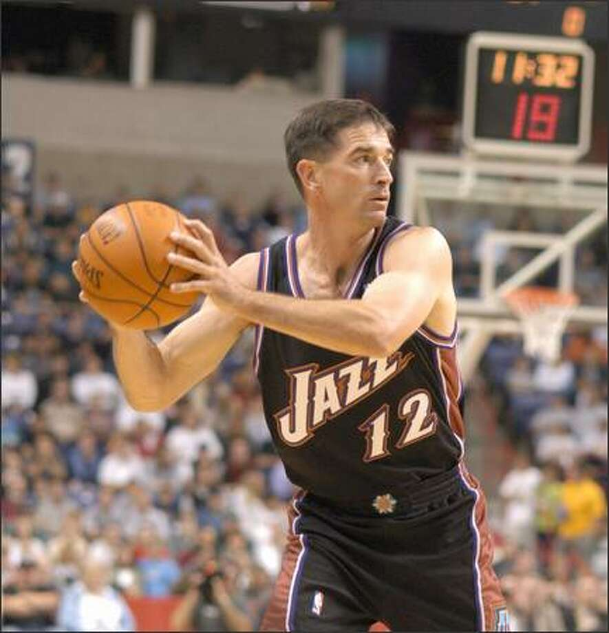 Jazz point guard John Stockton looks to pass last night in Spokane in Utah's 89-82 win over the Sonics. Photo: / Associated Press