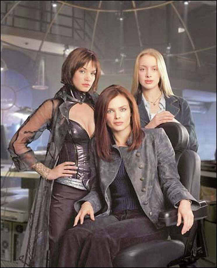"""""""Birds of Prey,"""" a drama about female crime fighters, stars Ashley Scott as Huntress, Dina Meyer as Oracle and Rachel Skarsten as Dinah. See more photos"""
