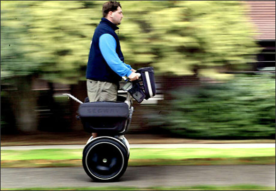 Troy Stockwell, a meter reader for the city of Seattle, tries out the Segway Human Transporter along East Calhoun Street in Seattle yesterday. Photo: Renee C. Byer/Seattle Post-Intelligencer