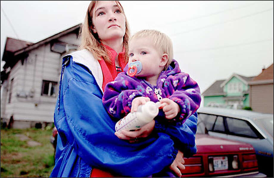 Amanda Smith, 18, and her daughter Sierra, 1, leave after a recent visit to the Everett Food Bank. Smith's boyfriend has a job but the family still qualifies for food-bank help. Photo: Paul Joseph Brown/Seattle Post-Intelligencer