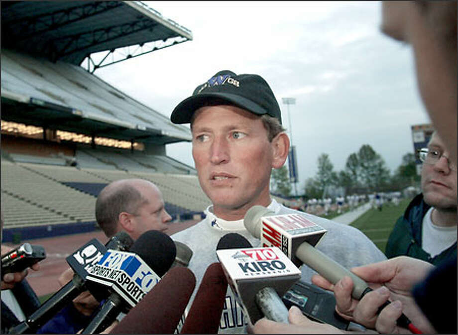 Washington football coach Rick Neuheisel talks with reporters about NCAA sanctions yesterday at Husky Stadium. Neuheisel's ability to recruit prospective players will be severely compromised. Photo: Dan DeLong/Seattle Post-Intelligencer