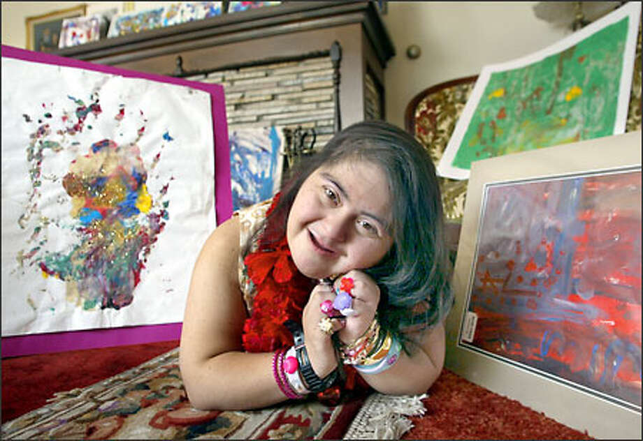 """Lupita Cano's art cards feature her vibrant, joyful artwork. Two of her favorite paintings are """"Liberty's Hand,"""" left, and """"Flag of Happiness."""" Photo: Renee C. Byer/Seattle Post-Intelligencer"""