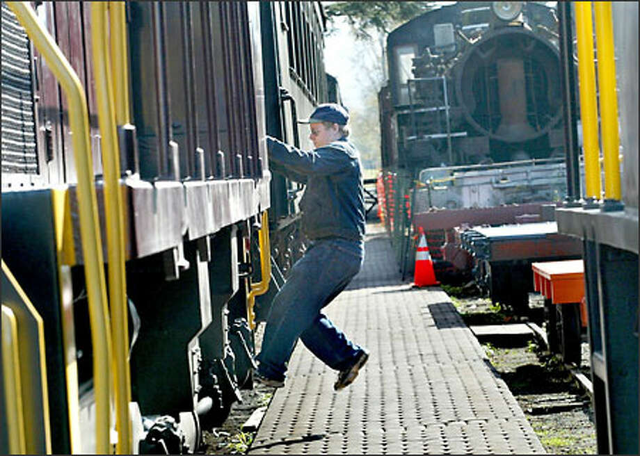 Dale Campbell jumps off an engine at the Northwest Railway Museum in Snoqualmie. Photo: Renee C. Byer/Seattle Post-Intelligencer