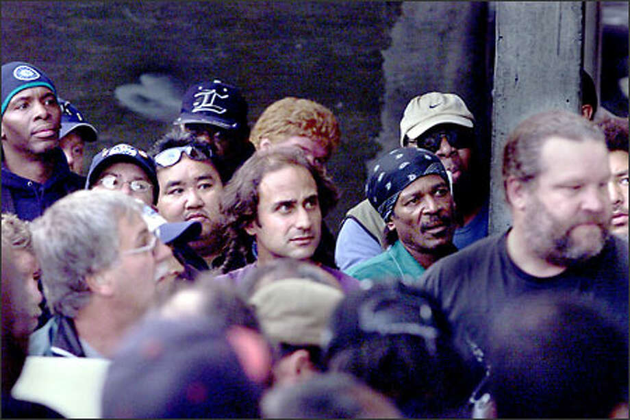 Longshoremen wait at the union hall to see whether or not there will be overflow work. Photo: Scott Eklund/Seattle Post-Intelligencer