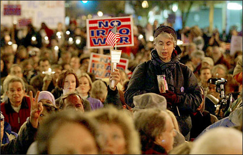 Ann Galvin-Eisenhart of Seattle stands out in a sea of anti-war demonstrators at Broadway and John Street on Capitol Hill last night. Some 3,000 protesters took to the streets. Photo: Dan DeLong/Seattle Post-Intelligencer