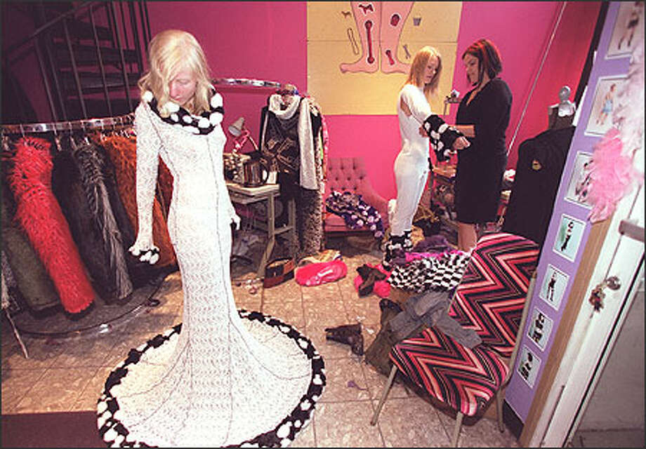 From right, Paula Fletcher, owner of Dumb Clothing, styles Sabrina Carter as Anna Telcs admires a dress that will be modeled in the Arena fashion show tomorrow. Photo: Loren Callahan/Seattle Post-Intelligencer