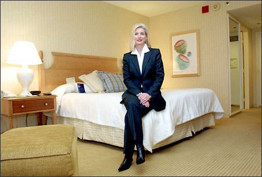 Carla Murray, vice president of Northwest operations for Starwood Hotels & Resorts Worldwide, pauses in one of the Sheraton Seattle Hotel & Towers' newly remodeled rooms. Photo: Phil H. Webber/Seattle Post-Intelligencer