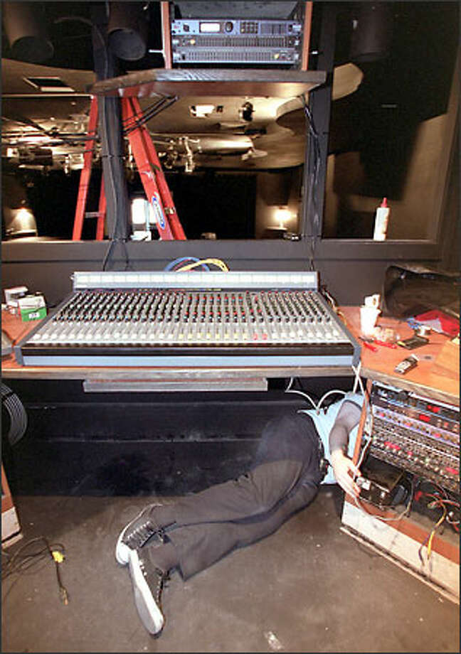 Audio engineer Jeff McCollough installs sound equipment at the Vera Project, a new all-ages music and arts venue that opens today. Photo: Loren Callahan/Seattle Post-Intelligencer