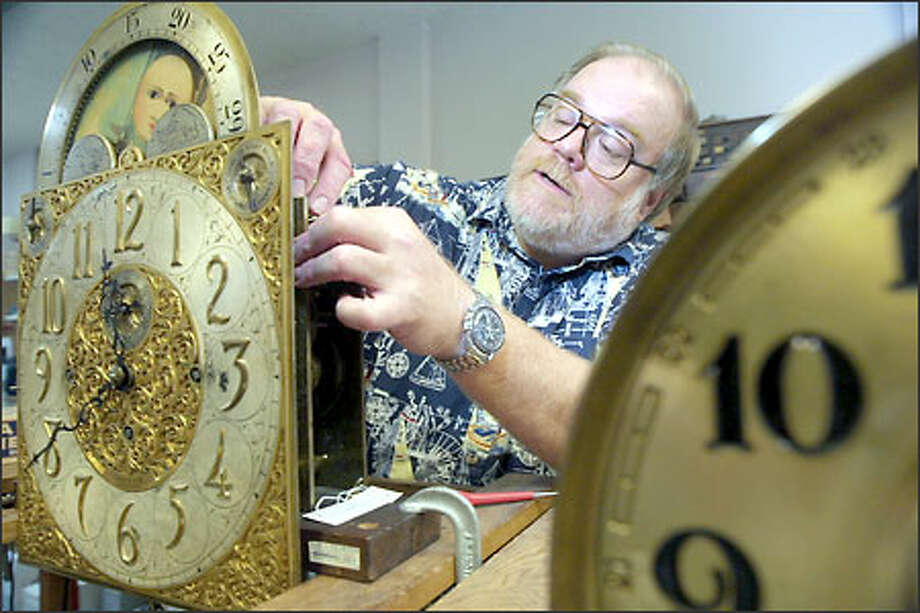 Brian Boyett, co-owner of Ballard Time Shop, works on a tubular bell grandfather clock made by Sheeve and Co. Photo: Phil H. Webber/Seattle Post-Intelligencer