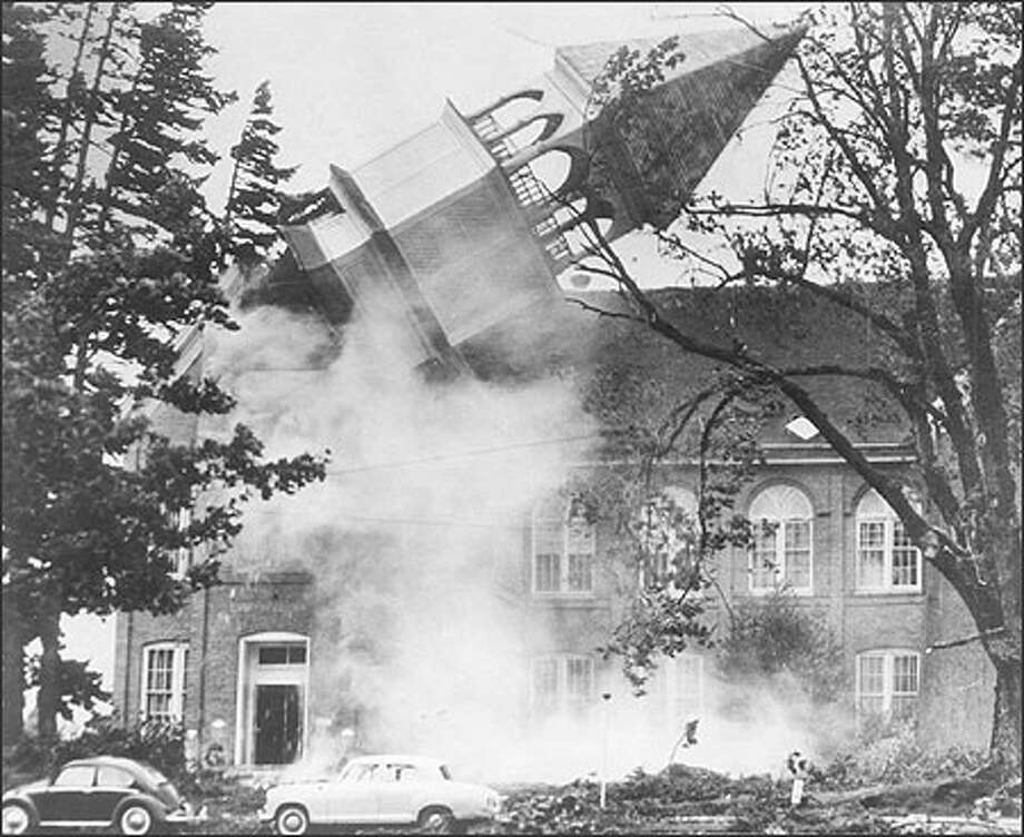 The spire on Campbell Hall on the campus of the Oregon College of Education topples in Lincoln City, Ore., during the Columbus Day storm, in October 1962. Today, the campus is known as Western Oregon University in Monmouth. The Columbus Day Storm 40 years ago, unexpectedly left a path of death and destruction from Northern California to the Canadian border and east as far as Montana. Photo: / Associated Press