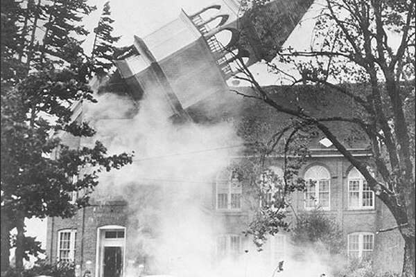 The spire on Campbell Hall on the campus of the Oregon College of Education topples in Lincoln City, Ore., during the Columbus Day storm, in October 1962. Today, the campus is known as Western Oregon University in Monmouth. The Columbus Day Storm 40 years ago, unexpectedly left a path of death and destruction from Northern California to the Canadian border and east as far as Montana.