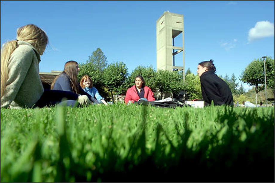 """Krystel Nysted, left, Julie Belin, Shana Lehar, Stephanie Somers and Emily Preston study the body, mind and soul. The college is structured in a way that """"nurtures everyone as learners,"""" an administrator said. Photo: Phil H. Webber/Seattle Post-Intelligencer"""
