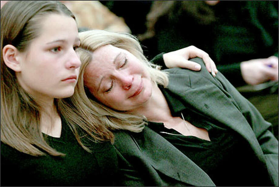 Denice Shoemaker sits with her daughter Ashley yesterday during sentencing of Roy Gursli for killing her oldest daughter, Carrie Shoemaker, in a hit-and-run accident last year. Photo: Grant M. Haller/Seattle Post-Intelligencer