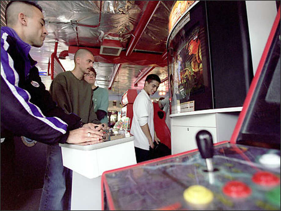 Masoud Rajab-Shahri of Bellevue plays a game against Blake McDermott at Quarters in Kirkland. The arcade recently closed, and owner Ryan Cravens will move to Spokane, where he will open an online gaming center. Photo: Loren Callahan/Seattle Post-Intelligencer