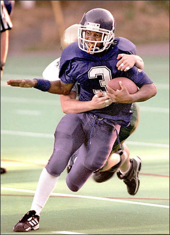 Garfield running back Brandon Sanchez has scored touchdowns rushing, receiving and on a fumble return this season. Photo: Scott Eklund/Seattle Post-Intelligencer
