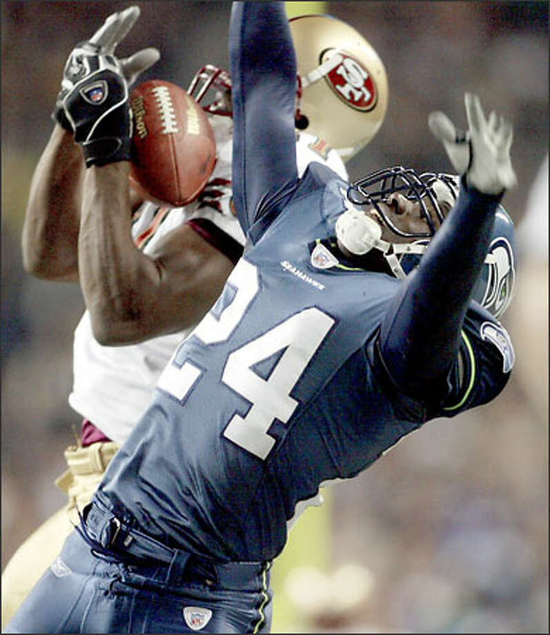 "Shawn Springs, getting beat Monday for the go-ahead touchdown, said 49ers QB Jeff Garcia and WR Terrell Owens are ""so in tune with each other, they deserved that play."" Photo: Dan DeLong/Seattle Post-Intelligencer"
