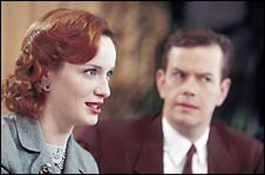 Christina Hendricks, left, portrays Audrey, who works at a small TV network in New York in 1948, and Dylan Baker plays the Colonel. Photo: Erik Heinla