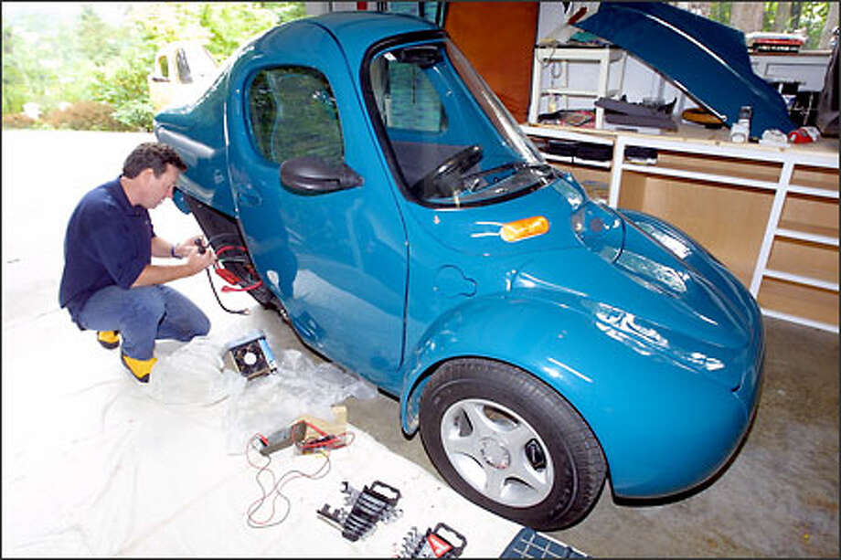 Alastair Dodwell Services A Three Wheel Corbin Sparrow Electric Vehicle At His In Kirkland