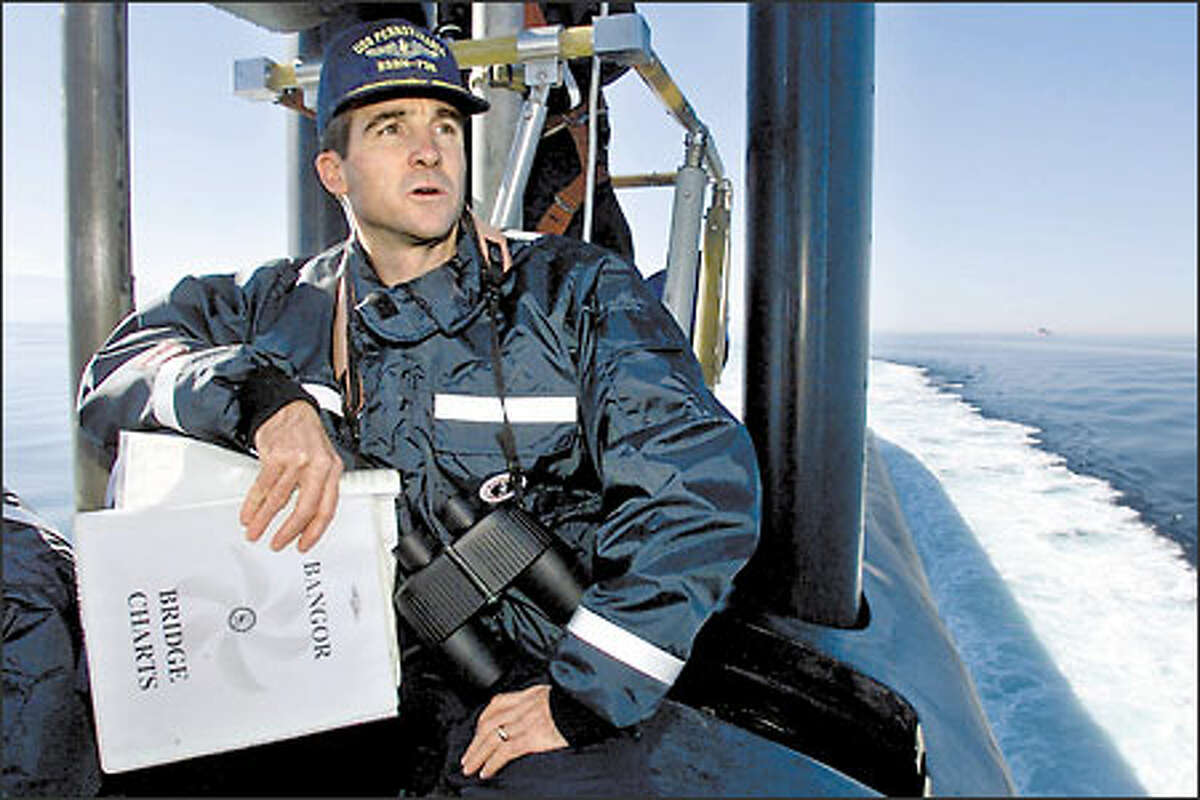 Cmdr. Ken Perry, the commanding officer of the Pennsylvania, surveys Puget Sound from the bridge of the 160-man Ohio-class Trident submarine.