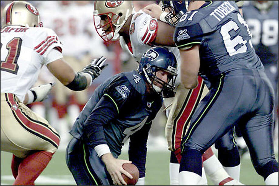 Seahawks quarterback Trent Dilfer, getting sacked against the 49ers, has a fourth-quarter QB rating of 47.5, which is 36th in the league. His third-down passer rating of 58.6 is 24th-best. Photo: Scott Eklund/Seattle Post-Intelligencer