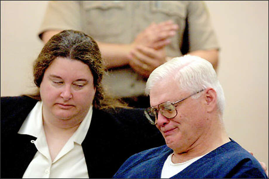 Defense lawyer Caroline Mann comforts David Schubert during the sentencing hearing, at which Schubert's son Andre said he did not believe his father was guilty of murder. Photo: Phil H. Webber/Seattle Post-Intelligencer