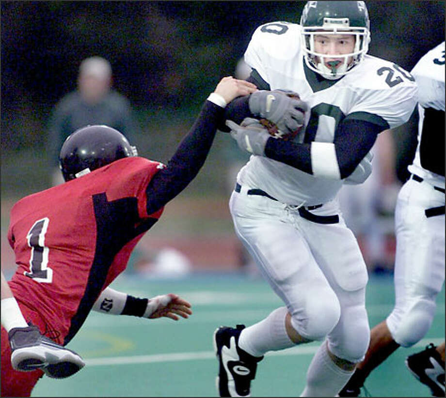 Kyle Trew runs through Mountlake Terrace safety Justin Christianson's tackle during Edmonds-Woodway's 42-35 victory over the Hawks. Photo: Scott Eklund/Seattle Post-Intelligencer