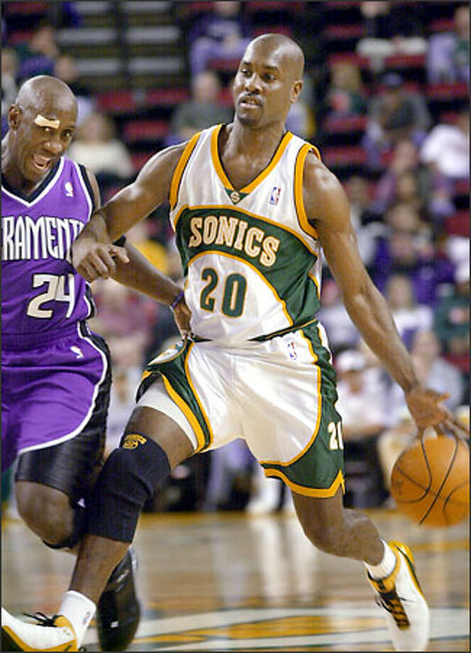 The Sonics' Gary Payton drives past Sacramento Kings' Bobby Jackson in the first half. Payton played only two quarters. Photo: / Associated Press