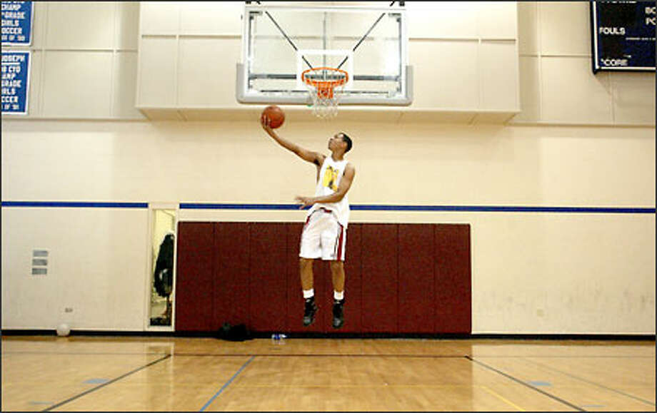 When Brandon Roy isn't working out at the St. Joseph church gym, he's working at a container company in West Seattle or hitting the books for his third Scholastic Aptitude Test. Photo: Mike Urban/Seattle Post-Intelligencer
