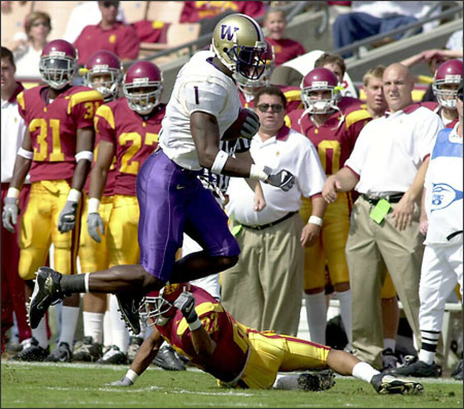 Washington wide receiver Reggie Williams, breaking a tackle by USC's Darrell Rideaux last Saturday, was not listed among the 10 semifinalists for the Biletnikoff Award. Photo: / Associated Press