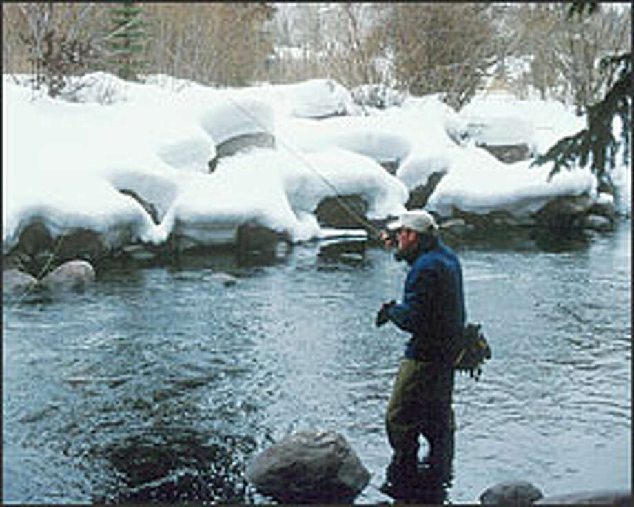 Mike Mulqueen fishes Gore Creek in Vail, Colo. Fishing enthusiasts near ski resorts are promoting skiing in the morning and fishing in the afternoon. Photo: THE ASSOCIATED PRESS