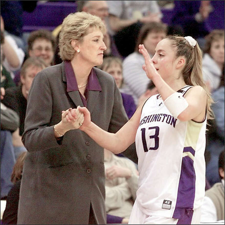 Washington's head coach June Daugherty shakes hands with point guard Giuliana Mendiola in the final seconds of their win over Southern California in March. Mendiola ranked eighth in the league in rebounding last season. Photo: / Associated Press