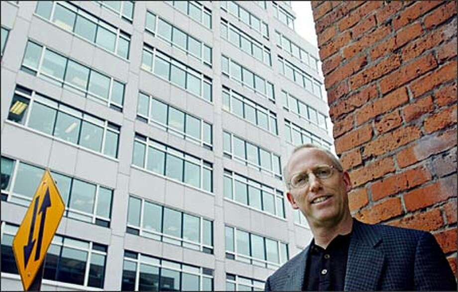 "Scott Adams, creator of ""Dilbert,"" pauses on a Belltown street yesterday. Weasels, he says, don't say what they mean or deliver what they promise -- unless it benefits them. Photo: Paul Joseph Brown/Seattle Post-Intelligencer"