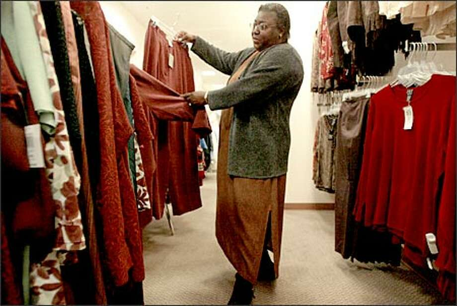 Mary Sampson of Seattle shops the Alfani Woman selection at The Bon Marche on her lunch hour. The Bon recently expanded its plus-size collection. Photo: Meryl Schenker/Seattle Post-Intelligencer