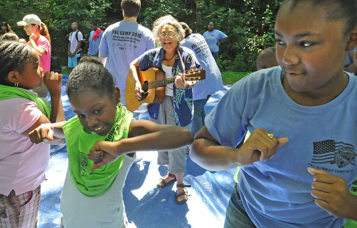 Music Mobile's founder and executive director Ruth Pelham plays for children in Sheridan Park in Albany on July 27, 2010. (Lori Van Buren / Times Union)