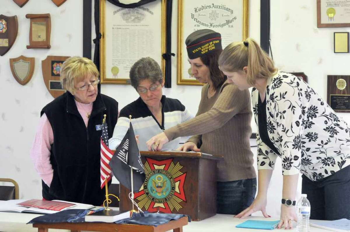 In this Feb. 20, 2011 photo, Veterans of Foreign Wars West Seneca Post 12097 members Judy Pollina, Beth Maddigan, Marlene Roll and Leonora Schreck prepare to start their monthly meeting in West Seneca, N.Y., a suburb of Buffalo. West Seneca Post 12097 is the first women's VFW Post in the United States. (AP Photo/Dan Cappellazzo)