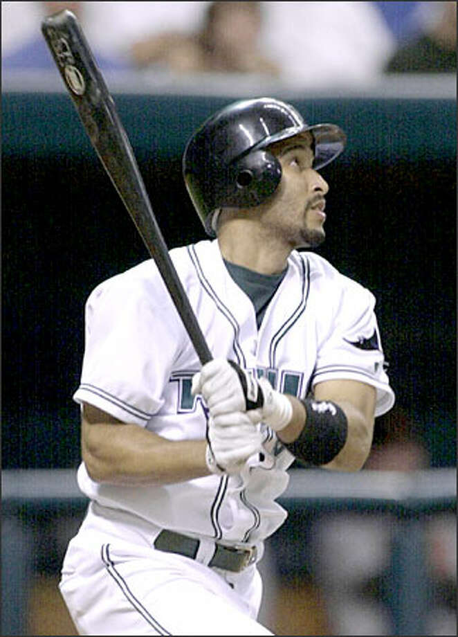 New Mariner Randy Winn had a breakthrough 2002 season with the Tampa Bay Devil Rays; the switch-hitting outfielder batted .298, scored 87 runs, hit 14 home runs and stole 27 bases en route to a berth on the American League All-Star team. Photo: / Associated Press