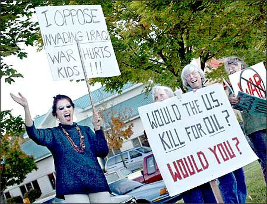 Grace Hawkins of Port Orchard, Betsy Collins of Kingston, Marion Kling of Eglon and Patty Bass of Poulsbo demonstrate in Silverdale against war with Iraq. Photo: Renee C. Byer/Seattle Post-Intelligencer