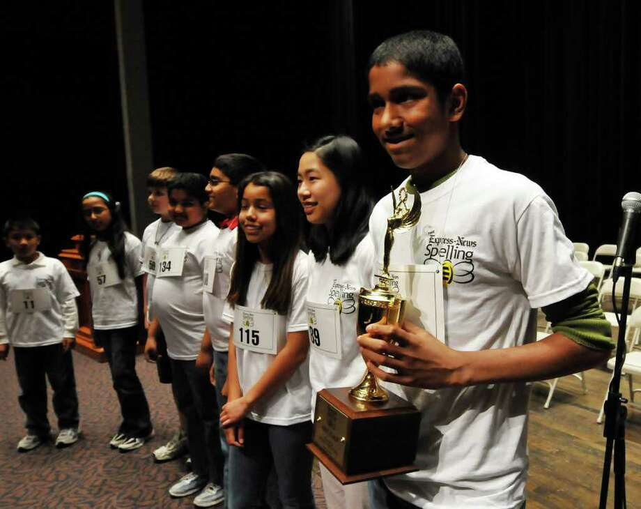 Abhinav Sangisetti (right), holding the winner's trophy, stands with finalists after the San Antonio Express-News' 58th annual Regional Spelling Bee at Trinity University's Laurie Auditorium on Saturday, March 12, 2011. Sangisetti won a trip to Washington, D.C., to compete in the Scripps National Spelling Bee. Photo: Robin Jerstad/Special To The Express-News / Robert Jerstad